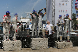 Podium: winners Sébastien Ogier and Julien Ingrassia, second place Mads Ostberg and Jonas Andersson, third place Jari-Matti Latvala and Miikka Anttila