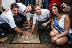 Hand imprint ceremony: 2013 24 Hours of Le Mans winners Loic Duval, Allan McNish and Tom Kristensen with Miss 24 Hours of Le Mans 2014