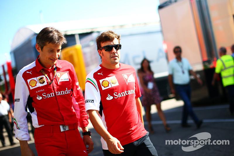 (L to R): Massimo Rivola, Ferrari Sporting Director with Fernando Alonso, Ferrari