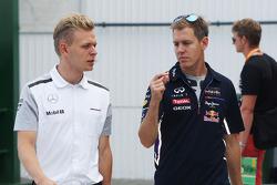 Kevin Magnussen, McLaren e Sebastian Vettel, Red Bull Racing