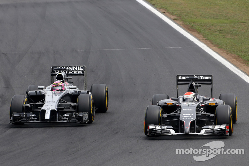 Jenson Button, McLaren F1 Team e Adrian Sutil, Sauber F1 Team
