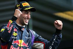 Podium: race winner Daniel Ricciardo celebrates