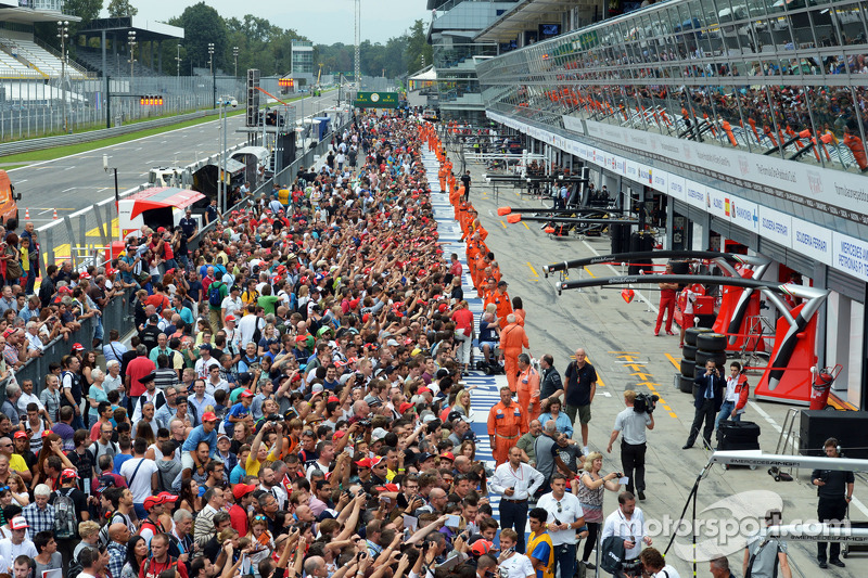 Fans in the pit lane