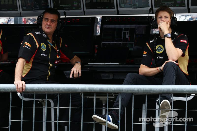 (L to R): Federico Gastaldi, Lotus F1 Team Deputy Team Principal with Romain Grosjean, Lotus F1 Team on the pit gantry