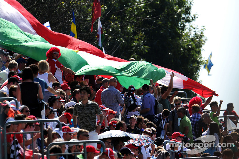 Fans with a large Italian flag