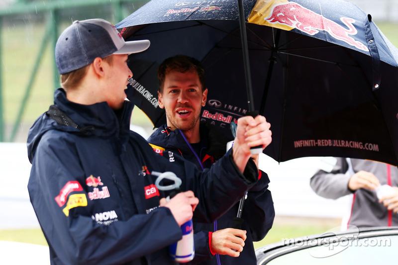 (L to R): Daniil Kvyat, Scuderia Toro Rosso and Sebastian Vettel, Red Bull Racing on the drivers parade