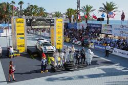 Podium: winners and 2014 WRC champions Sébastien Ogier and Julien Ingrassia, second place Jari-Matti Latvala and Miikka Anttila, third place Mikko Hirvonen and Jarmo Lehtinen