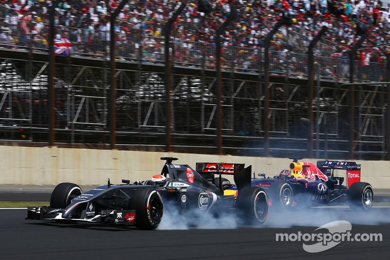 Adrian Sutil, Sauber C33 and Sebastian Vettel, Red Bull Racing RB10