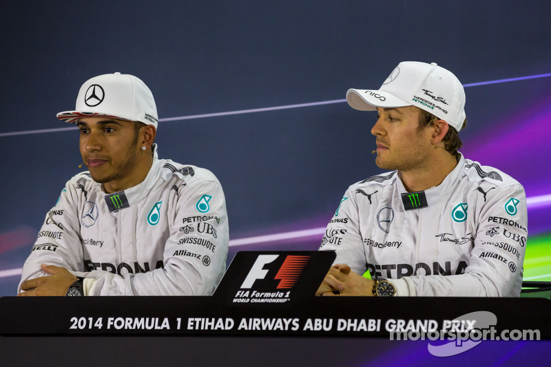 (L to R): Lewis Hamilton, Mercedes AMG F1 and team mate Nico Rosberg, Mercedes AMG F1 in the FIA Press Conference