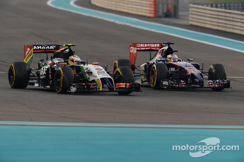 Sergio Pérez, Sahara Force India F1 VJM07 y Jean-Eric Vergne, Scuderia Toro Rosso STR9 pelean la posición