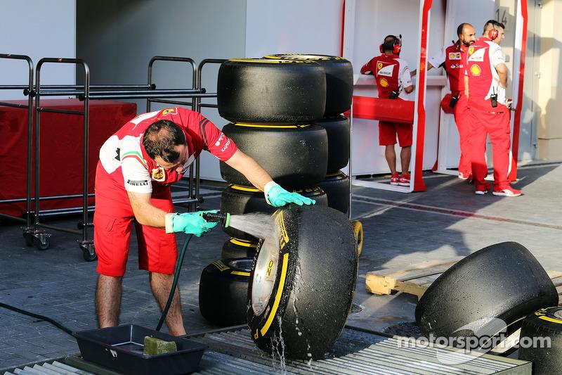 Ferrari mechanic washes Pirelli tyres