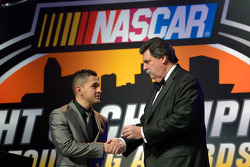 NASCAR Mexico Series champion Abraham Calderon gets a championship ring from NASCAR president Mike Helton