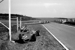 Giancarlo Baghetti, Ferrari 156 leads the Porsche of Dan Gurney, with retired Ferrari of Ritchie Ginther, by side of track
