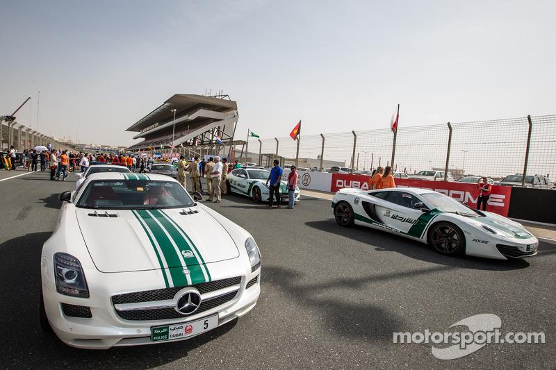 Dubai police exotic cars on display: a Mercedes AMG SLS, an Audi R8, a McLaren MP4-12C and a Ferrari