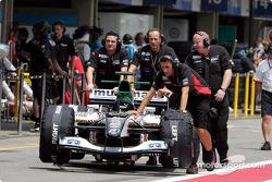 Minardi Formula 1 team members at work