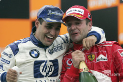 Podium: Juan Pablo Montoya and Rubens Barrichello celebrate