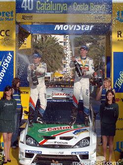 Podium: champagne for Markko Martin and Michael Park
