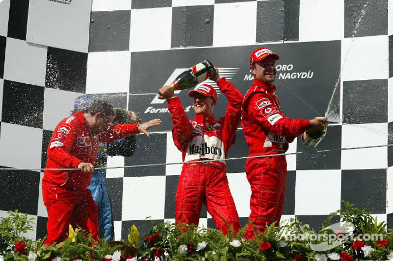 Podyum: Jean Todt, Fernando Alonso, Michael Schumacher ve Rubens Barrichello'nun şampanya kutlaması