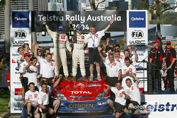 Podium: rally winners Sébastien Loeb and Daniel Elena celebrate with their team