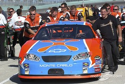 Cingular Wireless Chevrolet crew push the car to the qualifying line