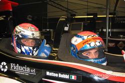 Former FIA GT Dünya Şampiyonu, Matteo Bobbi, gives yeni FIA GT Dünya Şampiyonu, Fabrizio Gollin, a ride