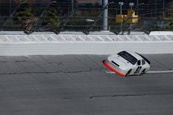 Kurt Busch runs the high groove up against the SAFER barrier