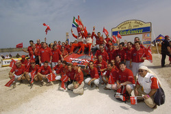 Giniel De Villiers and Jean-Marie Lurquin celebrate with Nissan Rally Raid team members