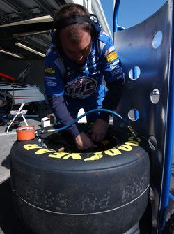 Miller Lite Dodge crew member prepares the tires