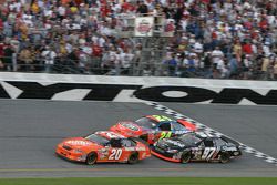 Tony Stewart, Jeff Gordon and Kurt Busch fight for the lead