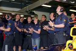 Red Bull Racing team members celebrate as David Coulthard takes provisional pole