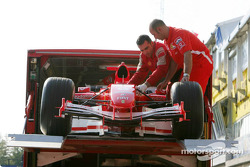 Spare car of Michael Schumacher arrives late in the afternoon