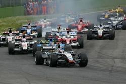 Start: Kimi Raikkonen takes the lead in front of Fernando Alonso