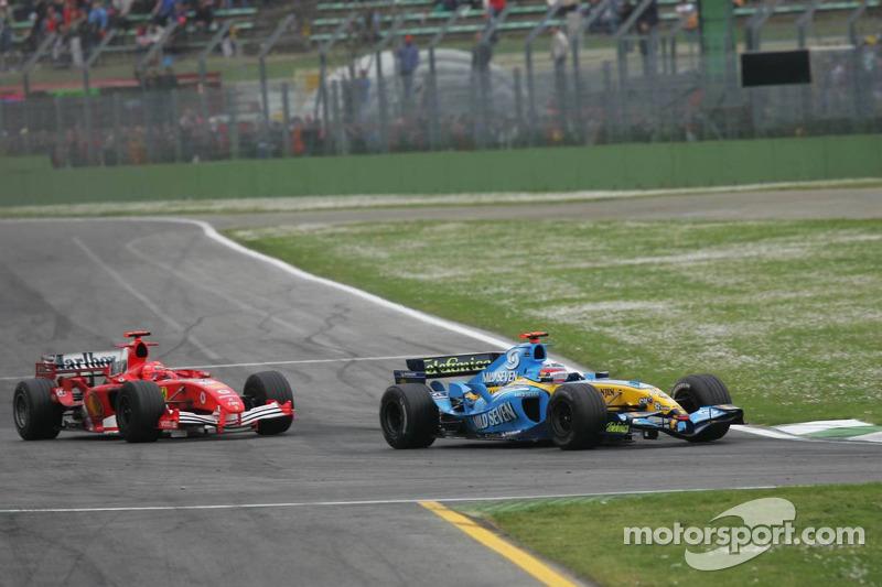Fernando Alonso and Michael Schumacher battle