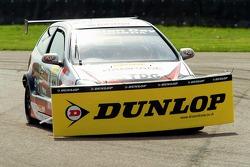 #10 Synchro Motorsport Honda Civic of James Kaye picks up some debris