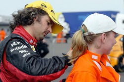 VX Racing driver Yvan Muller obliges a marshall with an autograph