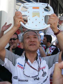 Tsutomu Tomita celebrates podium finish