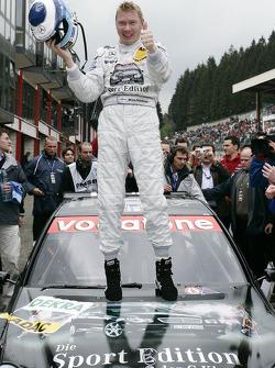 Race winner Mika Hakkinen celebrates