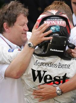 Race winner Kimi Raikkonen celebrates with Norbert Haug