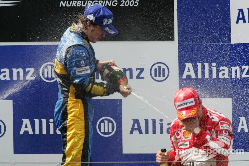 Podium: champagne for Fernando Alonso and Rubens Barrichello