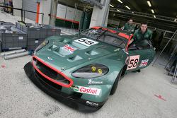 Aston Martin Racing team members push the car to scrutineering