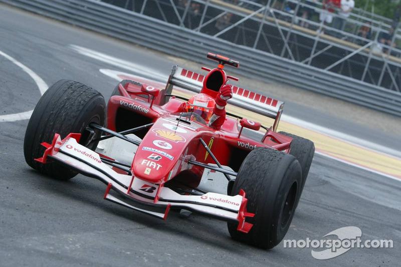 Michael Schumacher celebrates podium finish