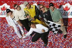 Podium: race winner Justin Wilson celebrates with team owner Carl Russo and RuSPORT team members