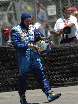Paul Tracy walks back to pit