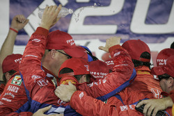 Victory lane: race winner Dario Franchitti celebrates with his team