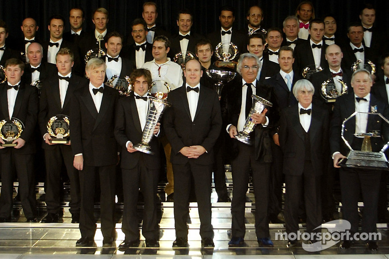 Max Mosley, Fernando Alonso, Albert of Monaco, Flavio Briatore and Bernie Ecclestone pose with the 2