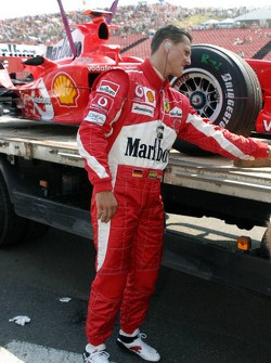 Michael Schumacher heads back to the pits