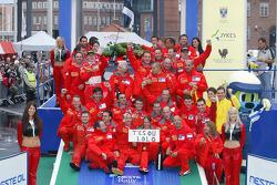 Winners Marcus Gronholm and Timo Rautiainen celebrate with Marlboro Peugeot Total team members