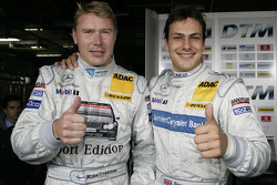 Pole winner Gary Paffett celebrates with Mika Hakkinen