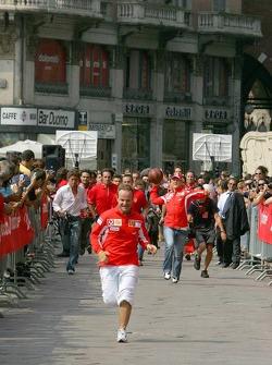 Vodafone race event in Milan: Rubens Barrichello beats Michael Schumacher at running race
