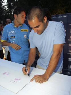 Juan Pablo Montoya and Giancarlo Fisichella autograph their hand-prints